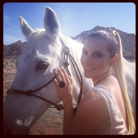 Pony! Oh, and Ke$ha modeling some of her gems--check out that spiked ponytail holder and that ring! Image Credit