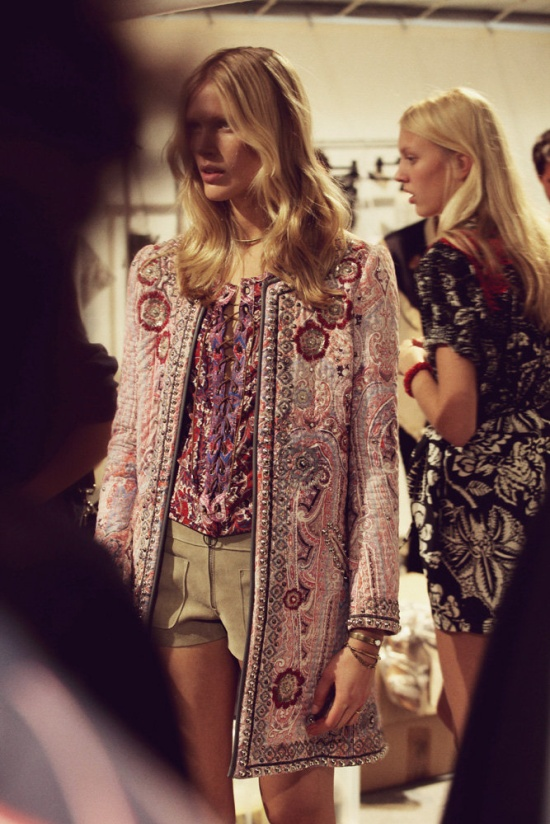 Another behind-the-scenes peek of Marant's S/S line at Paris Fashion Week...Totally dying over that tapestry coat! Image via Pinterest.