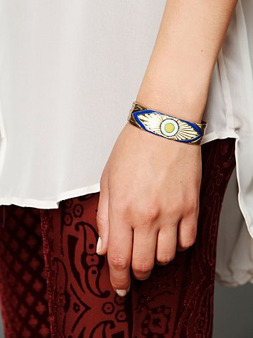 "My final pick is this multicolor enamel evil eye cuff by Dream Collective. Why? Because upon first glance, this doesn't even register as ""evil eye"" on my radar--just a cuff with a cool design. Subtle can be stylish. Buy at Free People."