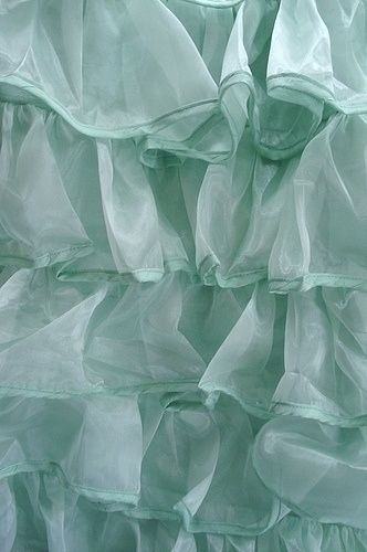 No worries--these aren't the kind of frills we're about to feature! (As much as I love tiers of cascading minty ruffles...sigh!) Image via Pinterest.