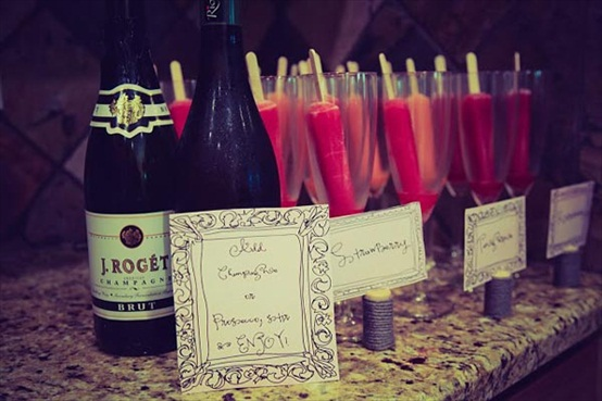If you want to go (extra) crazy with these pops, serve them in champagne flutes--complete with even MORE champagne, of course! Image via Pinterest.