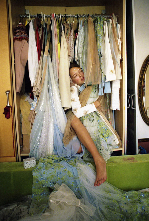 This image totally personifies the struggle of a clothing hoarder. I'm obsessed. Image Credit.