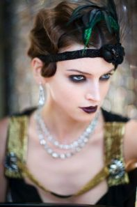 Tap into the 20s with this sophisticated flapper look using mascara, eyeliner, and lipstick.