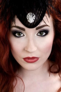 Liven your inner vampire with red lipstick, eyeliner, mascara, eyeshadow and a hint of blush.